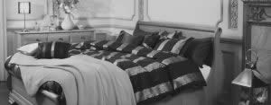 Black and White Image of Sleigh Bed with Furniture