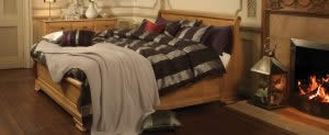 Sleigh Bed and Dark Bedding