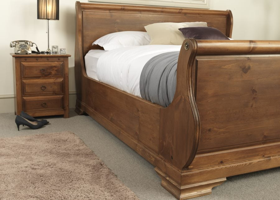 Sleigh Bed Footboard Detail with Bedside Cabinet