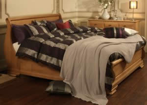 Oak Sleigh Bed with Damson Bedding and Oak Furniture