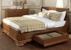 Sleigh Bed with Underbed Storage and Tartan Bedding