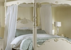 Drapes on Painted Four Poster Bed