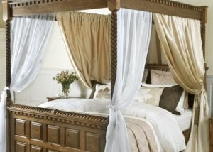 Luxury Gold Drapes on Traditional Wooden Four Poster Bed