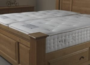 Memory Foam and Pocket Sprung Mattress on wooden bed