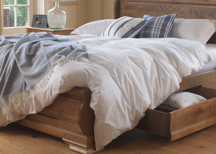 White Bedding and Underbed Storage on Sleigh Bed