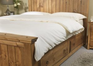 Duvet on Wooden Bed with Pillows