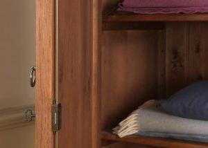 Wooden Shelf and Lock Detail on Wooden Wardrobe Door