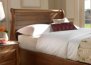 New England Sleigh Bed Headboard Detail in Natural Wood