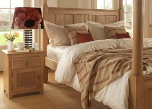 New England Four Poster Bed Headboard Detail with Oak Bedside Cabinet