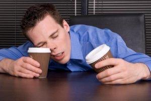 Man Asleep on Coffee Cup