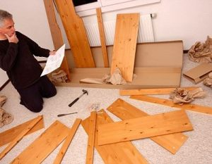 Person Putting Flat-pack Furniture Together