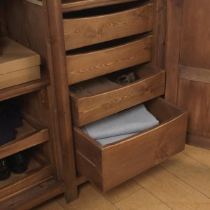 Handcrafted solid wooden drawers inside wooden wardrobe
