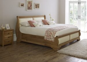 Oak Sleigh Bed with Cream Leather and 3 Door Bedside Cabinet