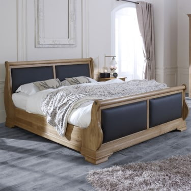 Solid Oak Sleigh Bed with Black Leather Panels