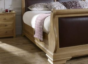 Close Up Detail of Solid Wood Sleigh Bed and Bedside Cabinet