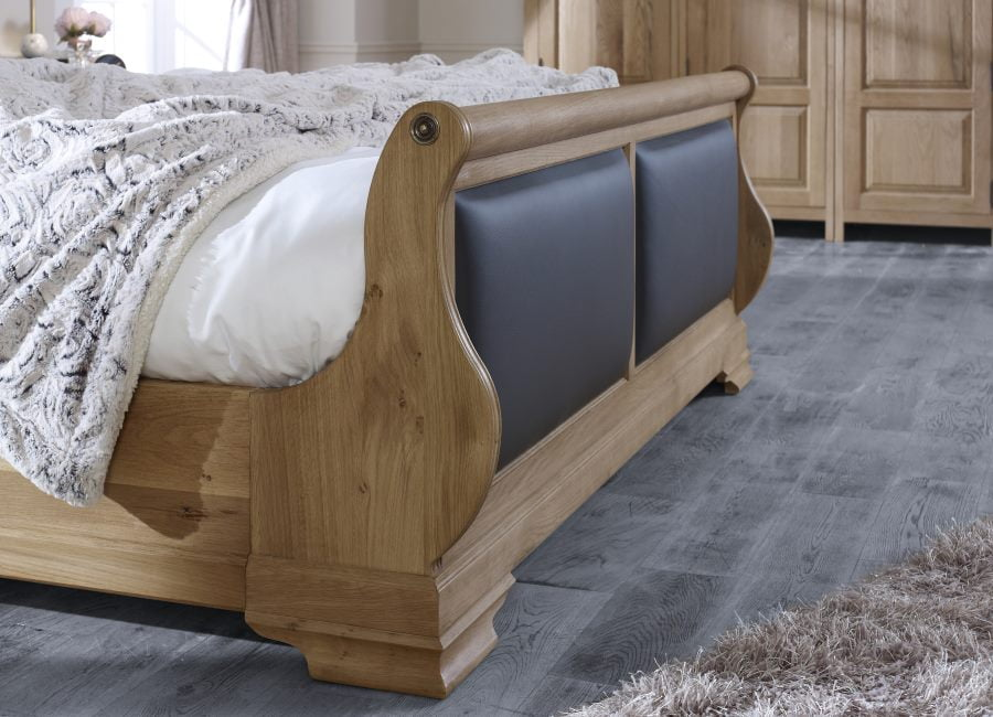 Oak Sleigh Bed Footboard Detail with Black Leather