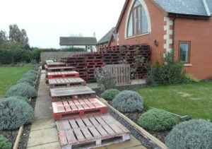 Stack of Pallets in Front Garden
