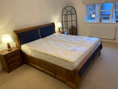 Wooden Sleigh Bed with Leather Insert Panels